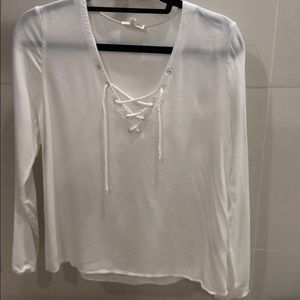 Long sleeve, small, white blouse. Ties in front.